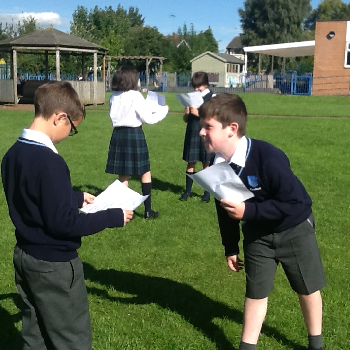 Acting out the battle scene from Romeo and Juliet.